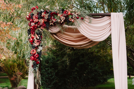 pomergranate: Autumnal wedding arch decoration of roses, apples, grape and pomergranate Stock Photo