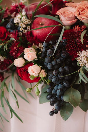 pomergranate: Autumnal wedding composition of roses, apples, grape and pomergranate