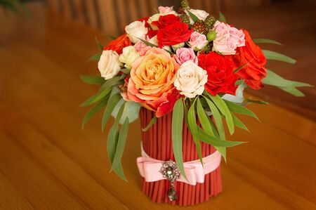 Tenderless bouquet in gaudy red and orange colours