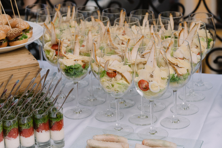 Tasty salad served in the wineglasses