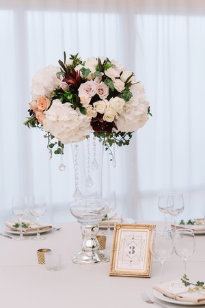 Magnificent Volume Bouquets Of Flowers In High Glass Vases Stock