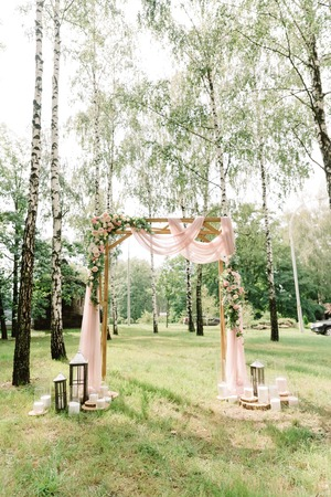 Stylish decor at a forest wedding among birches.