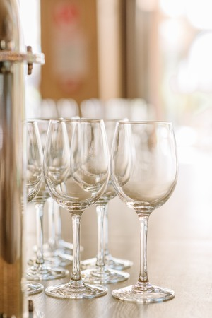 Clean beautiful glasses for alcohol on a table. 스톡 콘텐츠