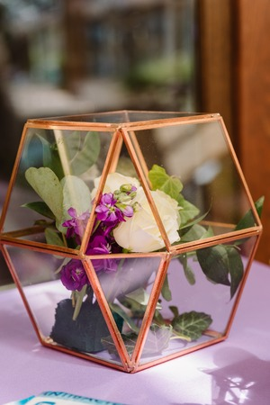 Flowers in a cage. Decoration at a wedding