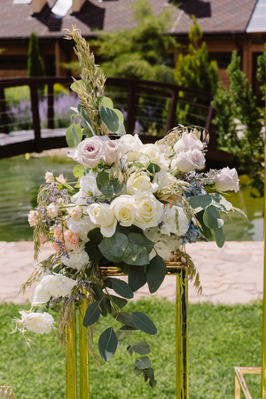 Elegant composition from wedding flowers on an arch