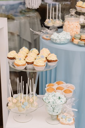 Sweets for guests at a wedding. Beautiful cakes and macaroons