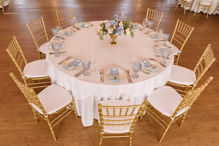 Festive lunch at restaurant. A wedding table for guests. Round banquet table