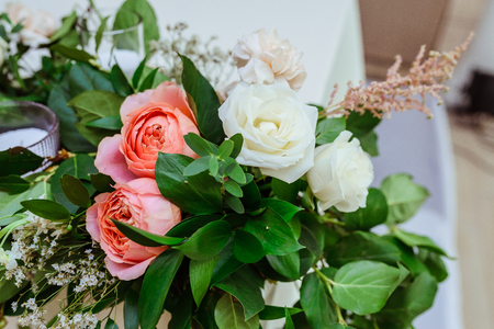 Bright and beautiful roses and greens.