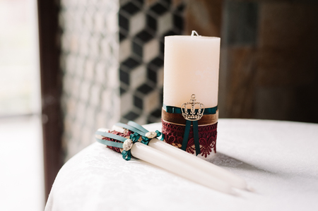 Wedding decorated candles with green and red in the elegant royal style on the table 스톡 콘텐츠 - 120043980