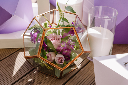Florarium with metal and glass flowers. Wedding details of an unusual form