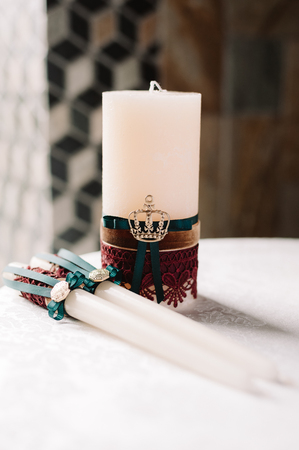 Wedding decorated candles with green and red in the elegant royal style