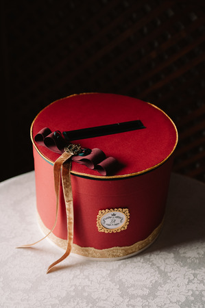 Red wedding box decoration in the royal style with ribbons 스톡 콘텐츠