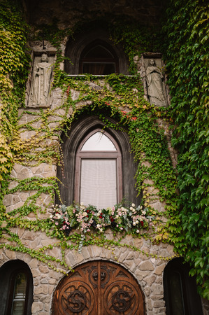 Old stone wall with a wedding decorated window