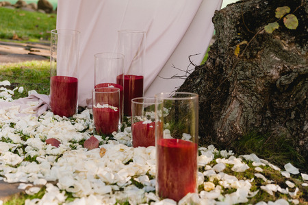 Beautiful wedding set up for the ceremony with candles 스톡 콘텐츠