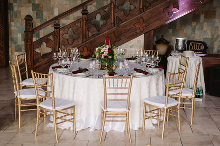 Wedding white table and chairs in the castle of love