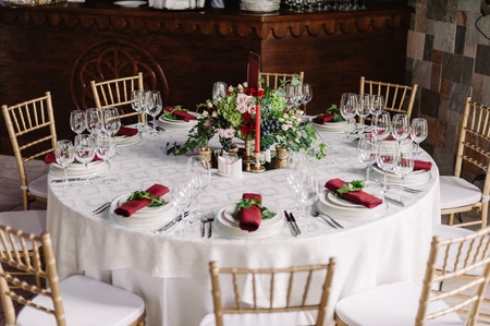 Wedding decorated white table and chairs in the castle of love