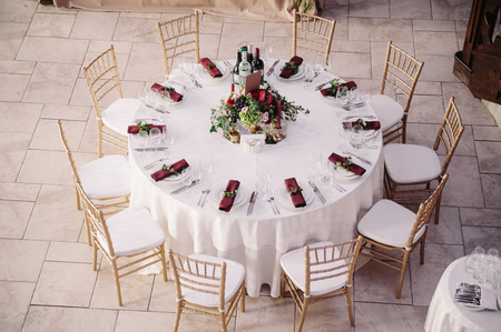 Interior of a wedding decorated table ready for guests, view from the top