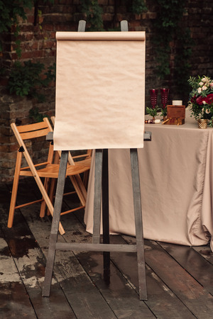 Wedding board, which stands on the easel, blank space, copy-space 스톡 콘텐츠