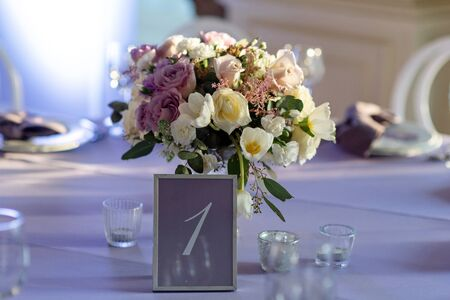 Wedding flowers and number of a table
