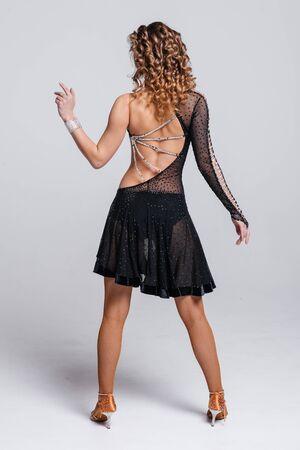 A beautiful female figure in a stylish translucent dress