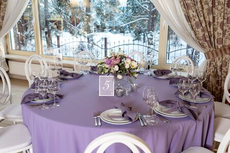 Beautiful round table for guests at a wedding