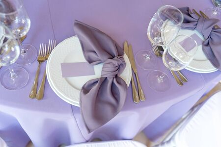 Stylish wedding details. Plate and fabric napkin