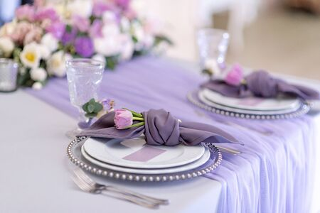 The fabric napkin decorated with a flower