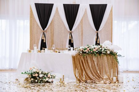 Wedding decorations in the great white hall of the restaurant. The grooms and brides table.
