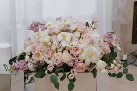 Festive table is luxurious decorated with aromatic flowers 스톡 콘텐츠