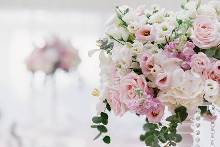A large plan of wedding flowers adorning the interior of the restaurant. Gentle wedding flowers on a blurred background