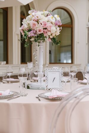 Luxury wedding table with beautiful flowers. Beautiful wedding bouquet on a tall white stand adorns the festive table Stock fotó