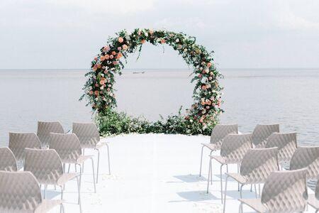Elegant and stylish decor wedding ceremony on the sea 스톡 콘텐츠