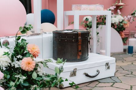 A stylish location for wedding photos decorated with retro suitcases, fresh flowers and original globes