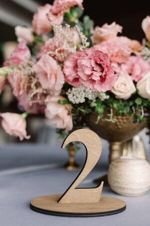 Table number, figure of wooden material. Luxury wedding decor 스톡 콘텐츠
