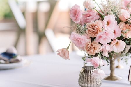 Beautiful wedding background. Flowers in an antique vase. Elegant natural flowers