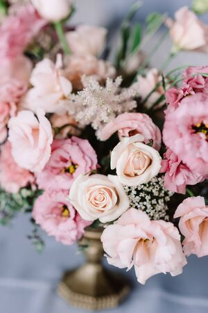 Elegant natural flowers beautifully decorate the table for a solemn reception