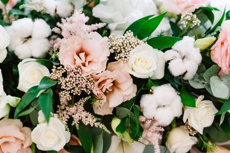 Original wedding floristics. The wedding flower bouquet is supplemented with natural twigs, berries and greenery. Gentle flower wallpaper made of fresh flowers