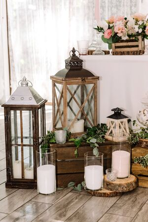 Elegant combination of pastel shades and forest wedding moives. Lots of decor of natural material near the groom and bride s desk. Wooden retro lights, white candles