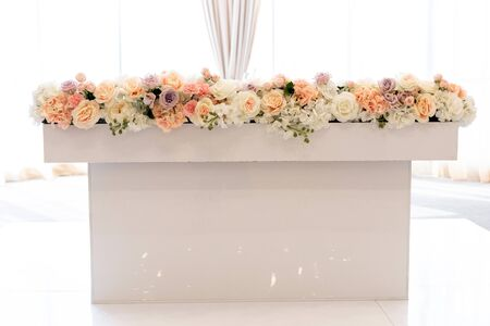 The groom and bride s table near large bright windows and decorated with beautiful natural flowers. Luxury wedding decoration Stock fotó