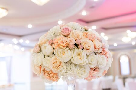 Trendy flower decor for a classic wedding in the restaurant s banquet hall. Luxurious bouquets of fresh flowers