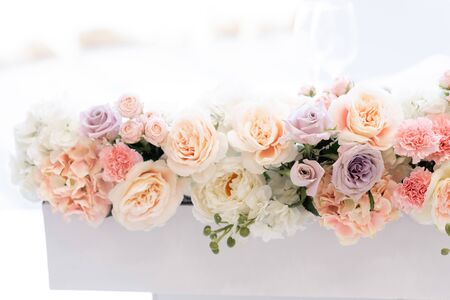Beautiful flowers on a white background. Wedding roses of different shades. Flower background