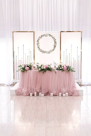 Wedding restaurant decor. Light color scheme with white and rose colors