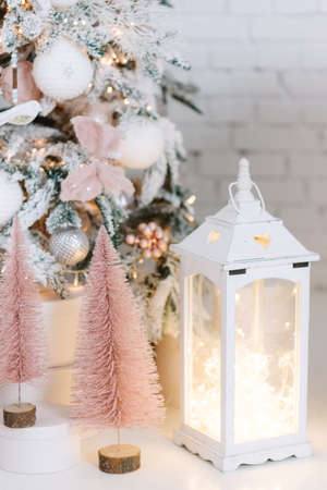 Christmas gifts under fir tree. Vintage New Year decorations. gift boxes and white lantern. Christmas mood. Celebrating of New Year
