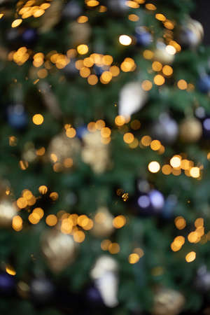 Abstract New Year background with beautiful boke. Christmas tree lights. Bright lights on the background of Christmas tree. Winter background 스톡 콘텐츠