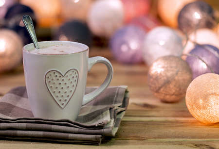 light breakfast: Cup with heart in a warm atmosphere with lights