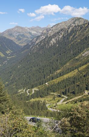 Road crosses a landscape of mountains in Austria (Grossglockner)