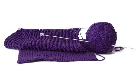 Knitting yarn and  needles with scarf inprogress.  Wool. photo
