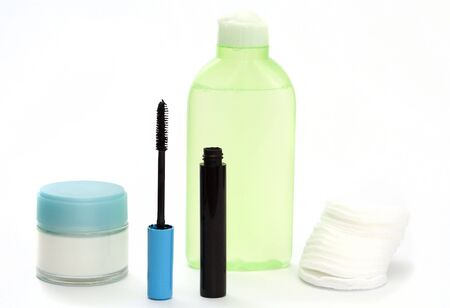 wadded: A lotion, a cream, ink for eyelashes, wadded disks on a white background