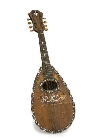 Very old mandoline on a white background Stock Photo