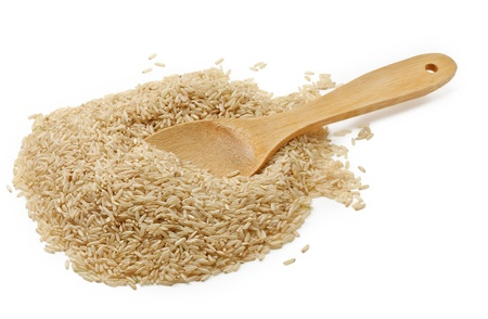 brown rice: brown rice over the spoon  Stock Photo